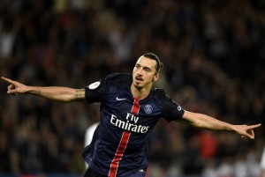 Paris Saint-Germain's Swedish forward Zlatan Ibrahimovic celebrates after he scored his team's fourth goal during the French L1 football match Paris Saint-Germain (PSG) vs Toulouse on November 7, 2015 at the Parc des Princes stadium in Paris. AFP PHOTO / FRANCK FIFE