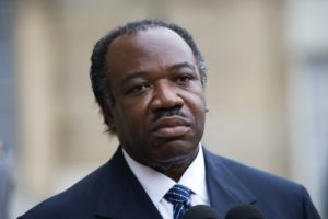 Gabon's President Ali Ben Bongo speaks to the media in the courtyard at the Elysee Palace in Paris