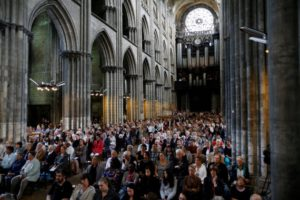 People attend a Mass in tribute to priest Jacques Hamel in the Rouen Cathedral on July 31, 2016. Muslims across France were invited to participate in Catholic ceremonies today to mourn a priest whose murder by jihadist teenagers sparked fears of religious tension. Masses will be celebrated across the country in honour of octogenarian Father Jacques Hamel, whose throat was cut in his church on Tuesday in the latest jihadist attack on France. / AFP PHOTO / CHARLY TRIBALLEAU